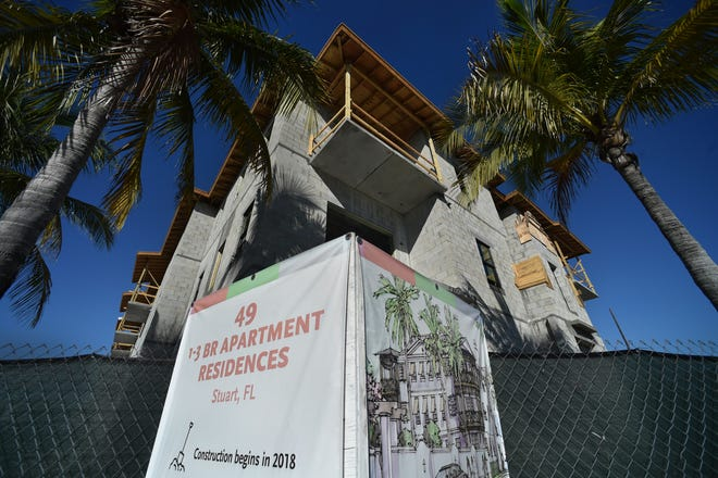 A three-story apartment complex -- featuring one-, two- and three-bedroom apartments -- is seen under construction on Wednesday, Nov. 21, 2018, along Southwest Joan Jefferson Way at the traffic Circle in downtown Stuart.