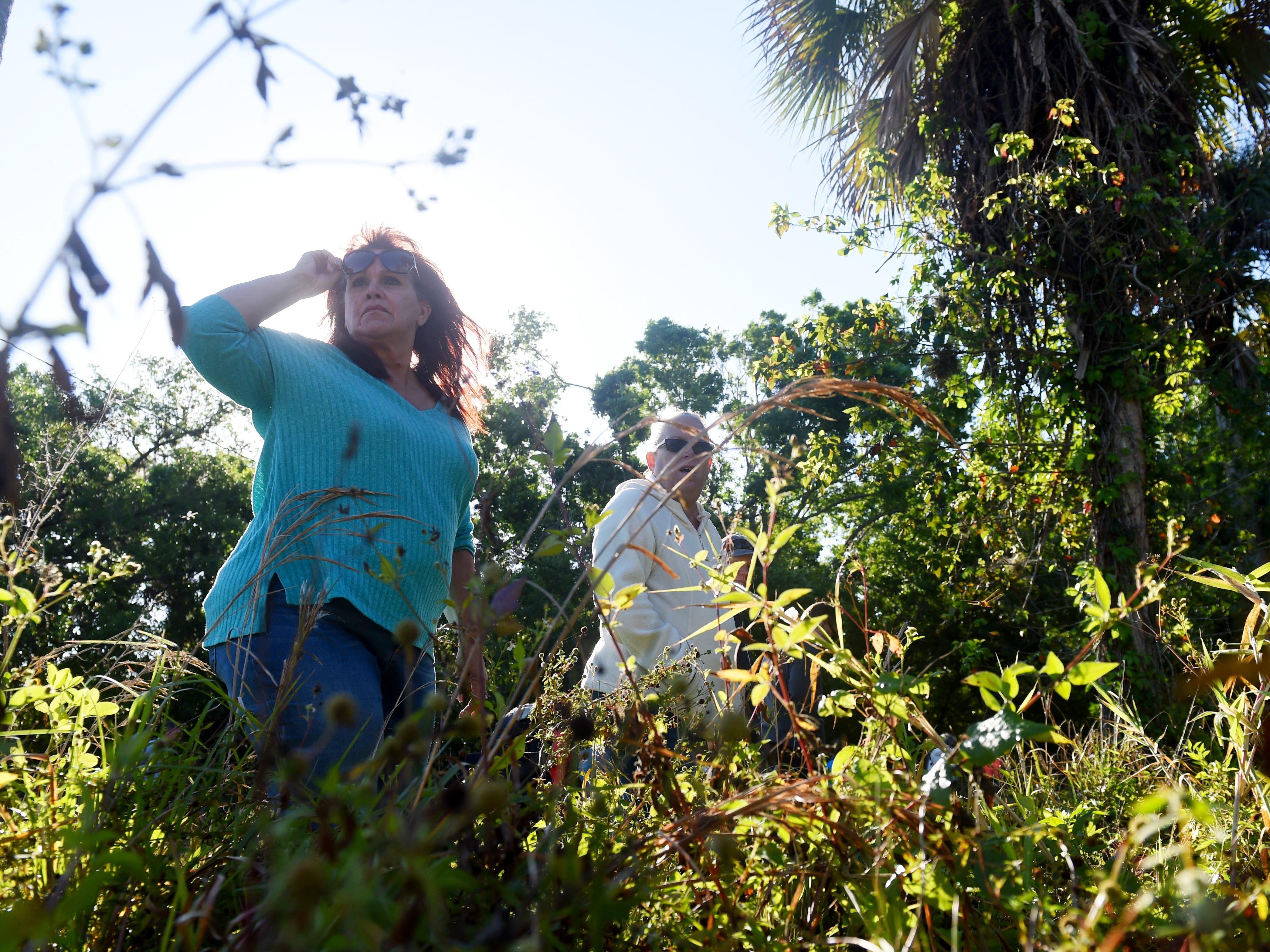"""Victoria Meissner (left) and Marcia Boyce, both of Vero Beach, make their way through thick brush as they take part in a search party on Wednesday, March 21, 2018 for a St. Lucie County woman who has been missing since Friday. Assunta """"Susy"""" Tomassi, who suffers from dementia, was last seen on foot along U.S.1 near Oslo Road Friday evening. The Indian River County Sheriff's Office helped in the search with a helicopter, K-9 units and all-terrain vehicles."""