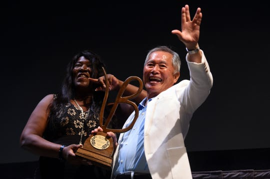 The fourth annual Vero Beach Wine & Film Festival is this weekend at multiple locations across the city. Best known for his role of Sulu on the original Star Trek television series, stage and film actor George Takei waves to the crowd with a 'live long and prosper' sign on Friday, June 8, 2018 after receiving the Life Worth Living Legend Award at the festival.