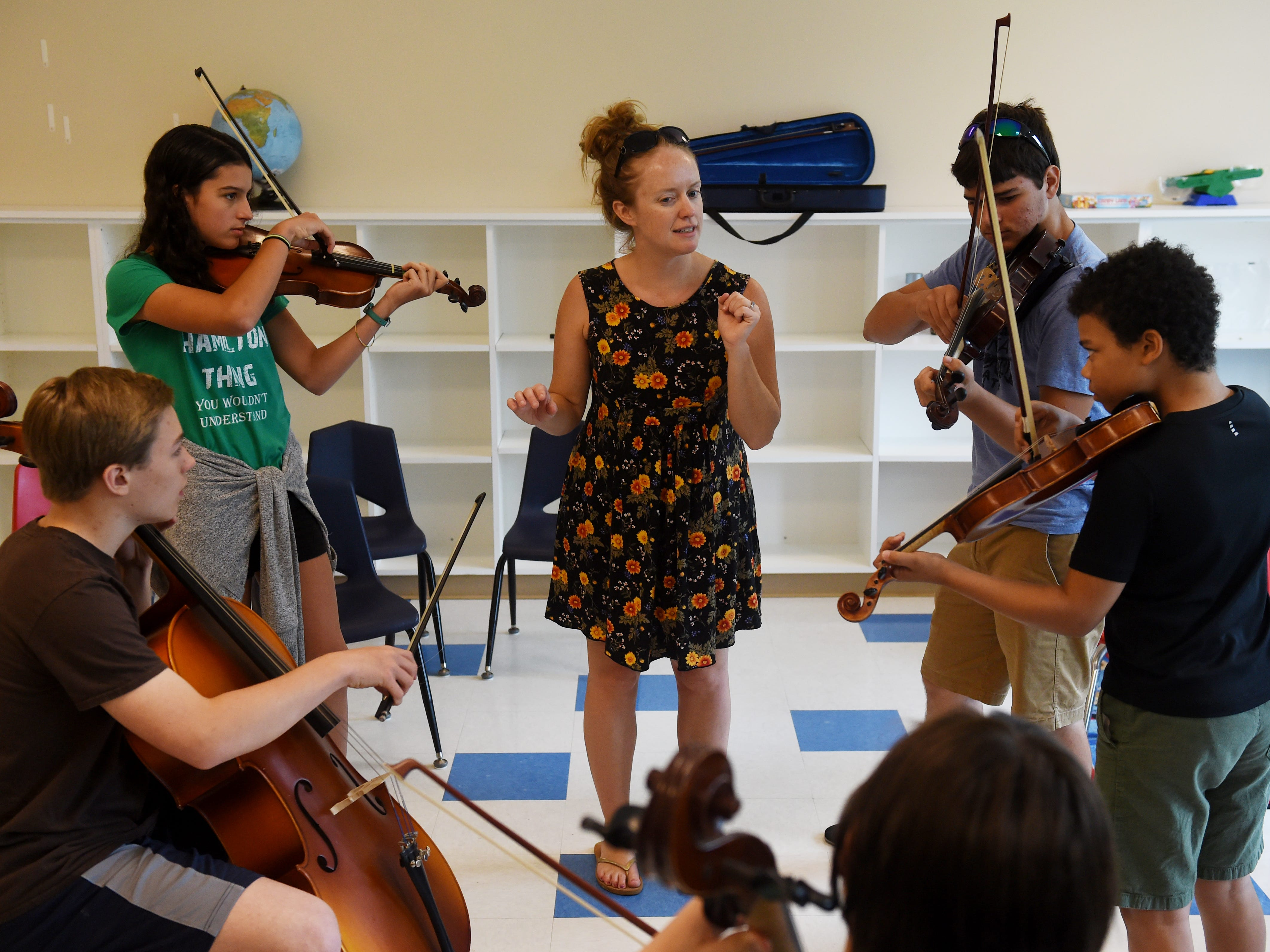"""Hanneke Cassel (center) guides Zadie Diniz (from left), Obed Barba, Gabriel Moore, Adrian Brubeck (not pictured), Colin Vellante and Zach Hessler during a band rehearsal on Thursday, July 12, 2018 at the 9th annual Mike Block String Camp at First Presbyterian Church in Vero Beach. """"Each year we've been growing in size for both students and faculty,"""" said Mike Block. """"The idea is for any string player, whether it's guitar, bass, violin or cello, we want people to learn different styles of music and then to use the music from different styles and put the students into bands to develop their own creativity."""" Students of the camp are placed into classes according to their ability and form bands that will perform for the public on Saturday, July 14 at 3:00 p.m. as part of The Vero Beach International Music Festival."""