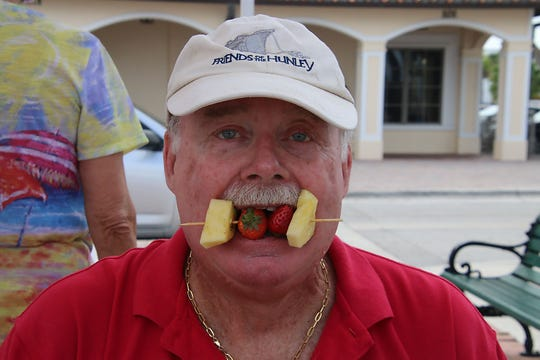 George McDaniel samples some of the yummy Waterside Blues fare at the Jazz & Blues Society concert in downtown Fort Pierce.