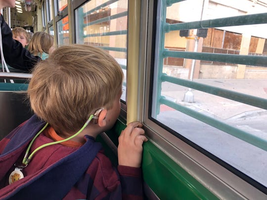 A child looks out the window on the El Paso Streetcar on Tuesday in Downtown El Paso.