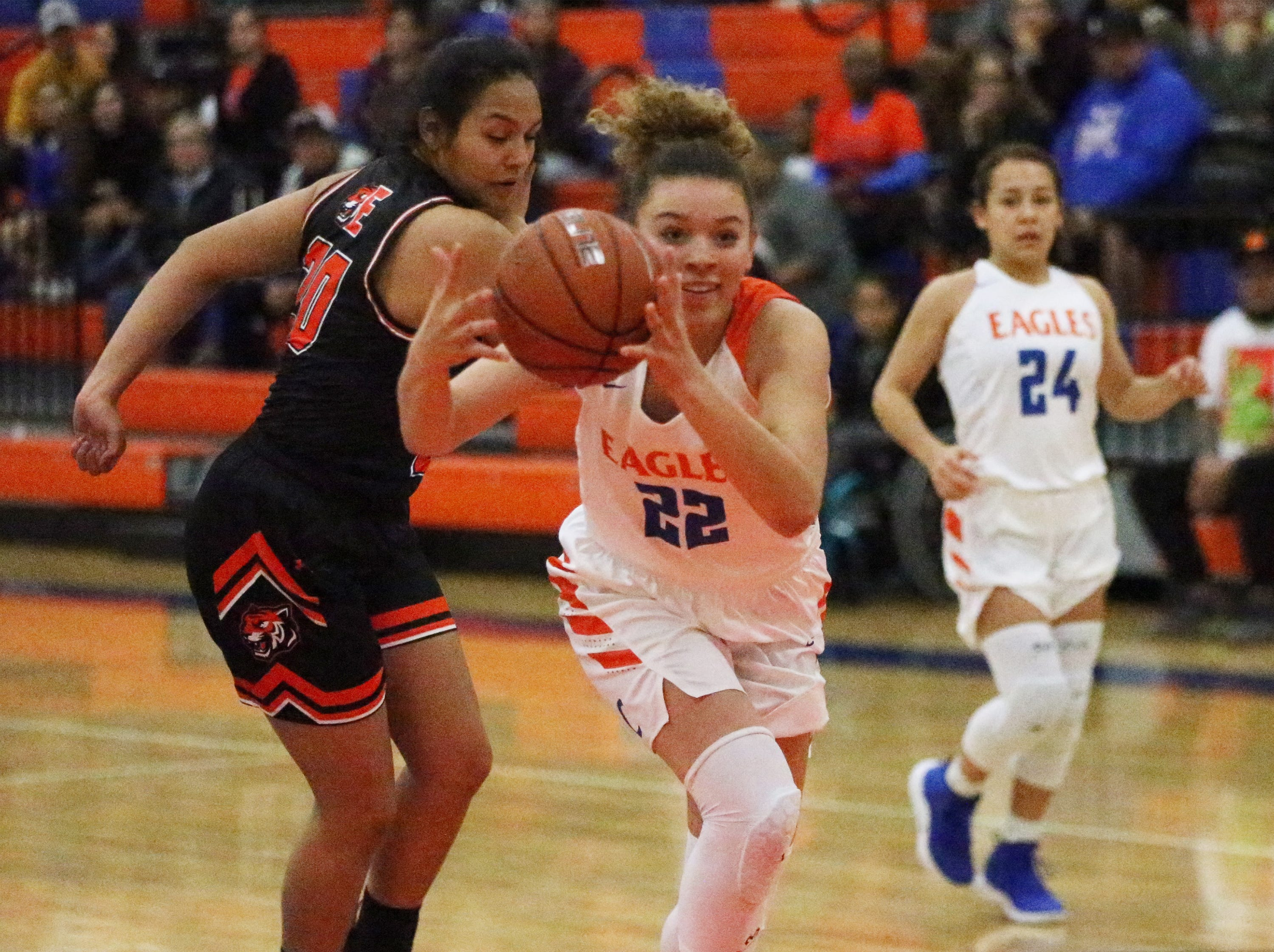 Sadi Clemons, 22, of Canutillo drives to the basket against El Paso High Tuesday night.