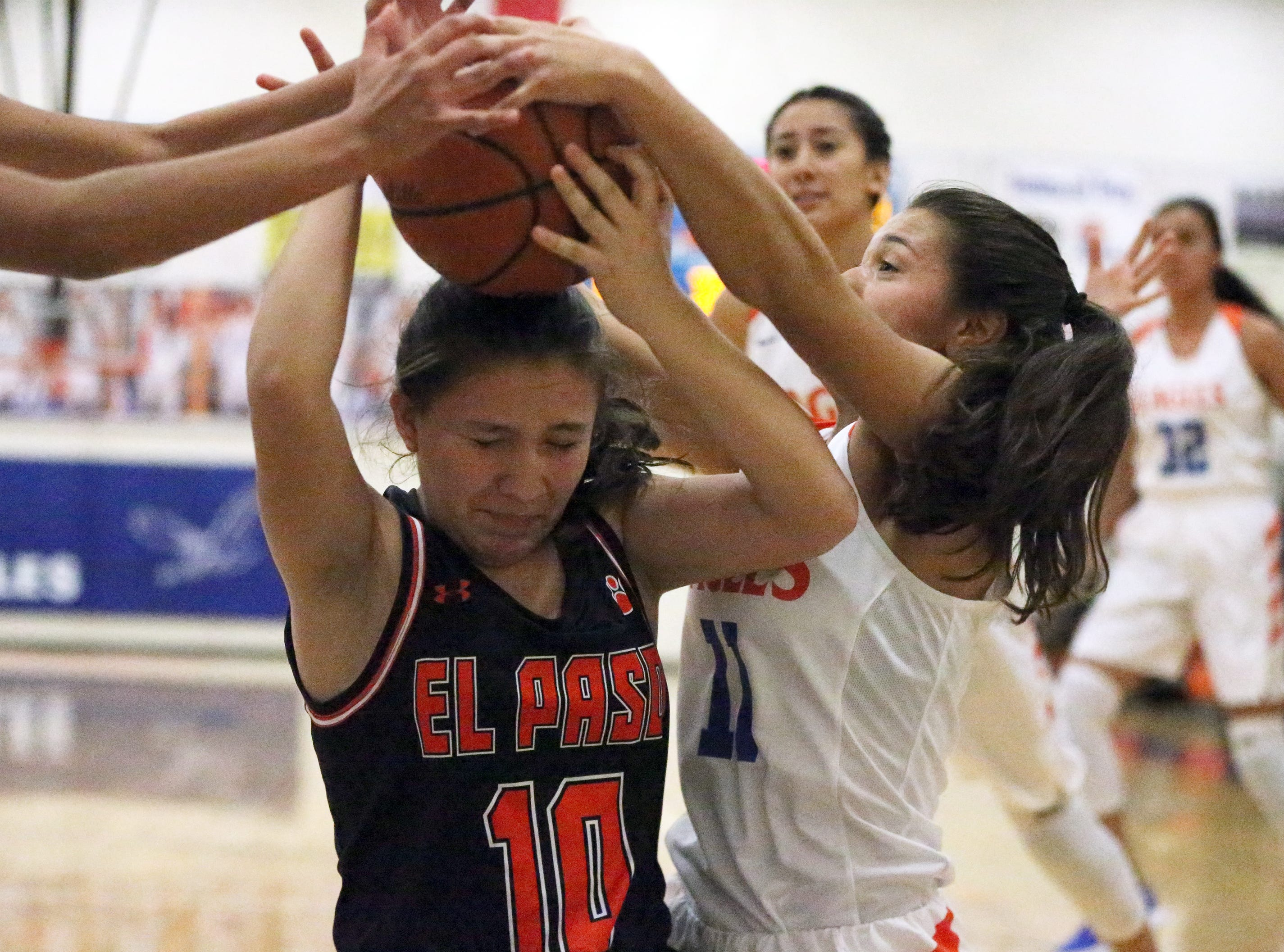 Jessica Barrett, 10, of El Paso High tries to hold on to the ball against Canutillo Tuesday night.