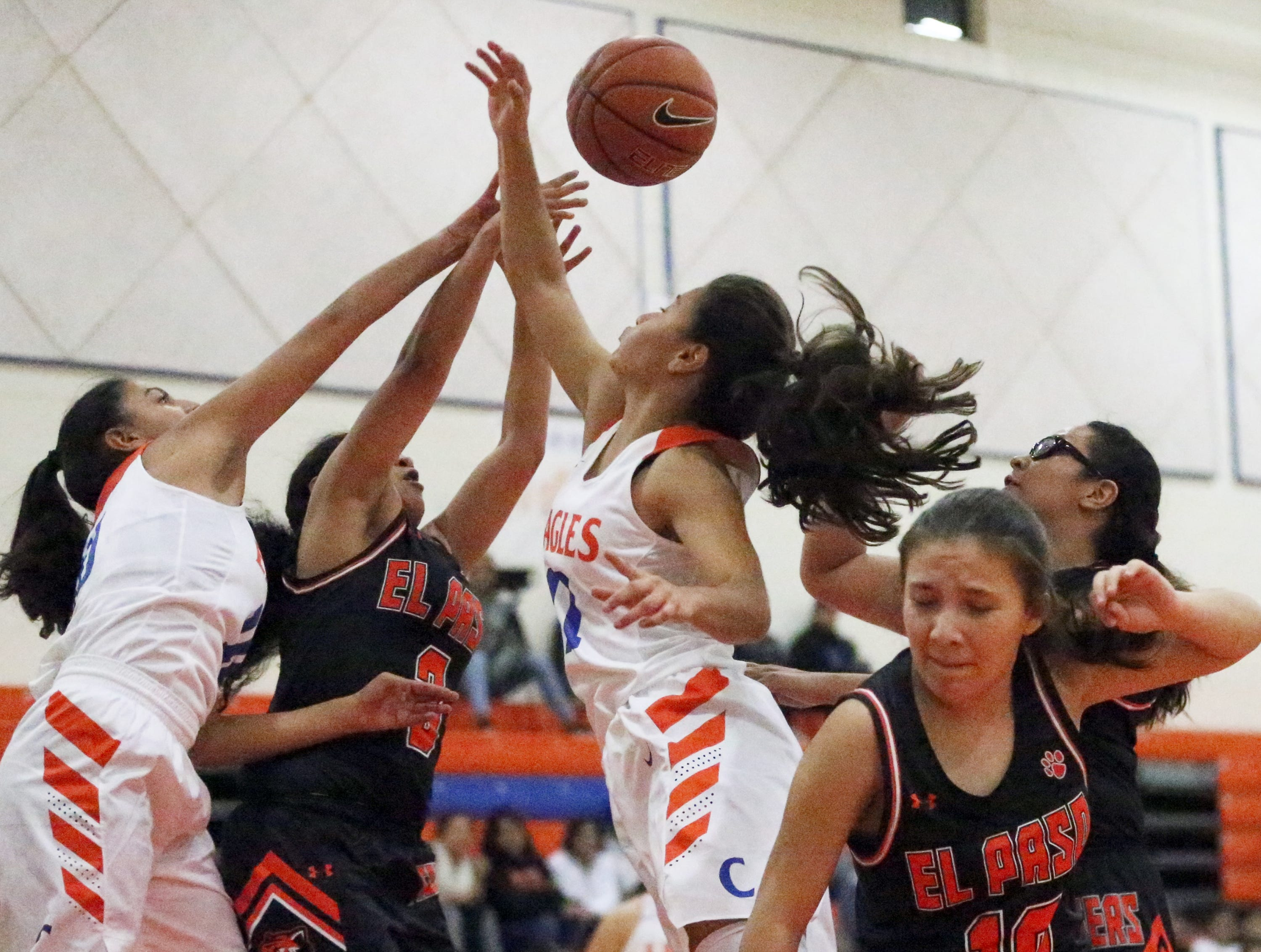 Canutillo and El Paso players battle for a rebound during their Tuesday night game at Canutillo.