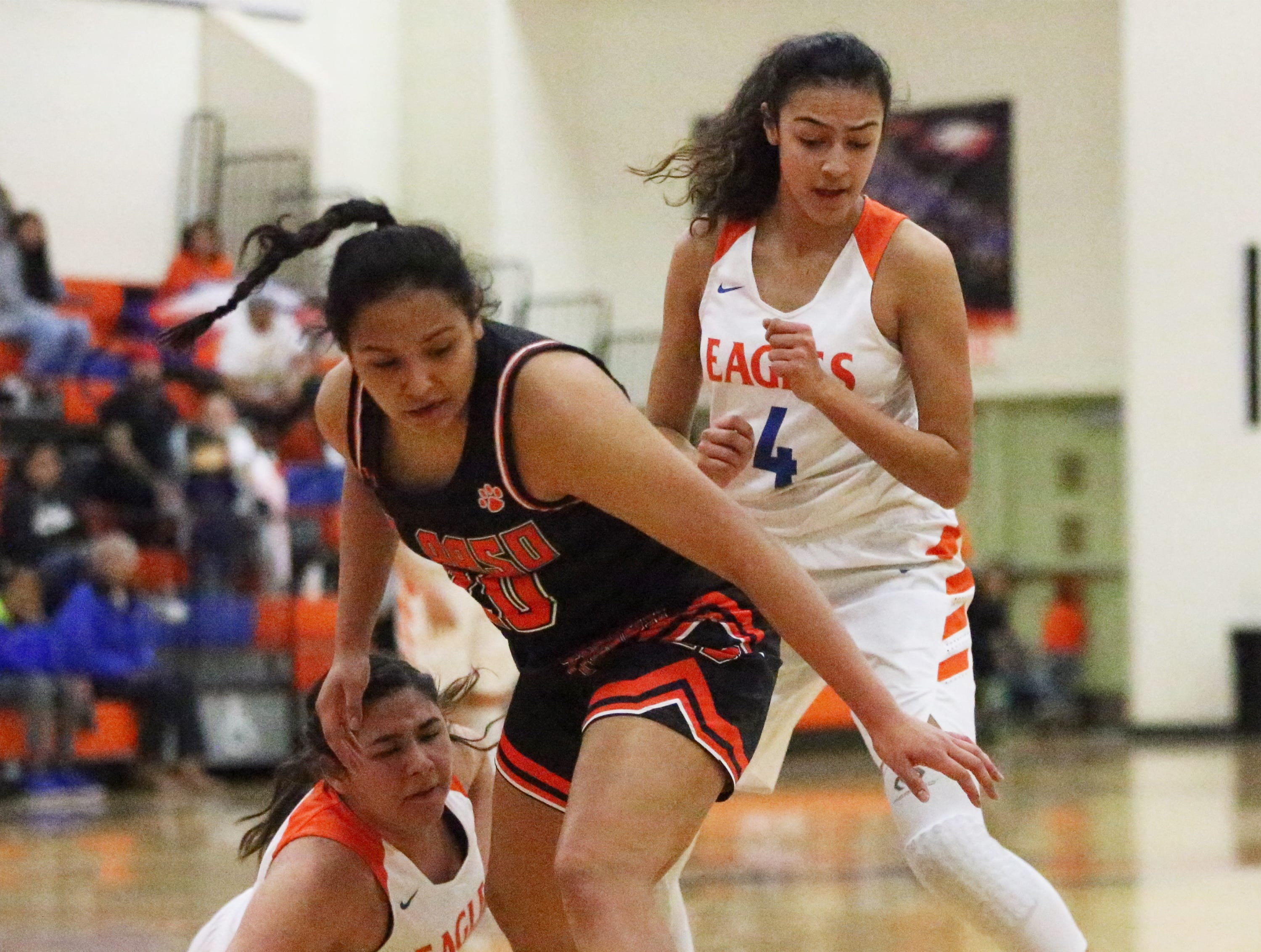 Mia Hernandez, center, of El Paso High goes after a loose ball against Canutillo Tuesday night at Canutillo.