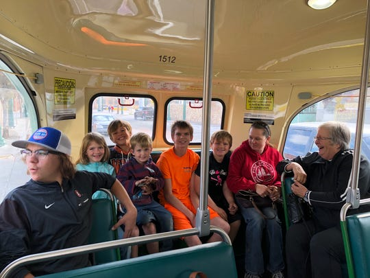 The Rystad family enjoys some time together on the El Paso Streetcar on Tuesday near Downtown El Paso.