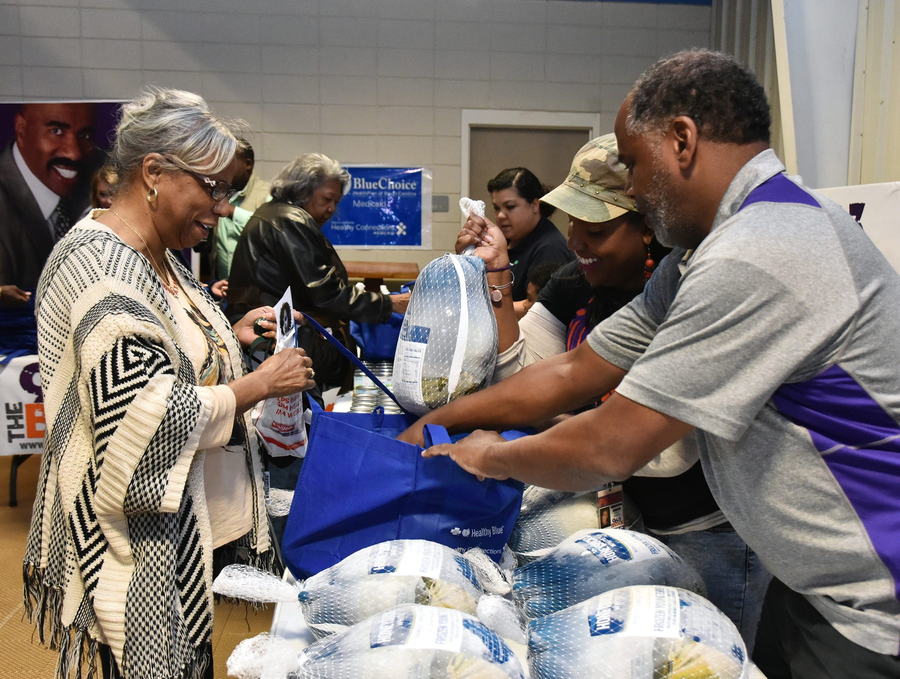 Duane Neal, an on-air personality at The Block, 96.3 in Greenville hands out turkeys during The Block presents The Steve Harvey Morning Show Turkey Give at the Freetown Community Center Tuesday evening, November 20, 2018.