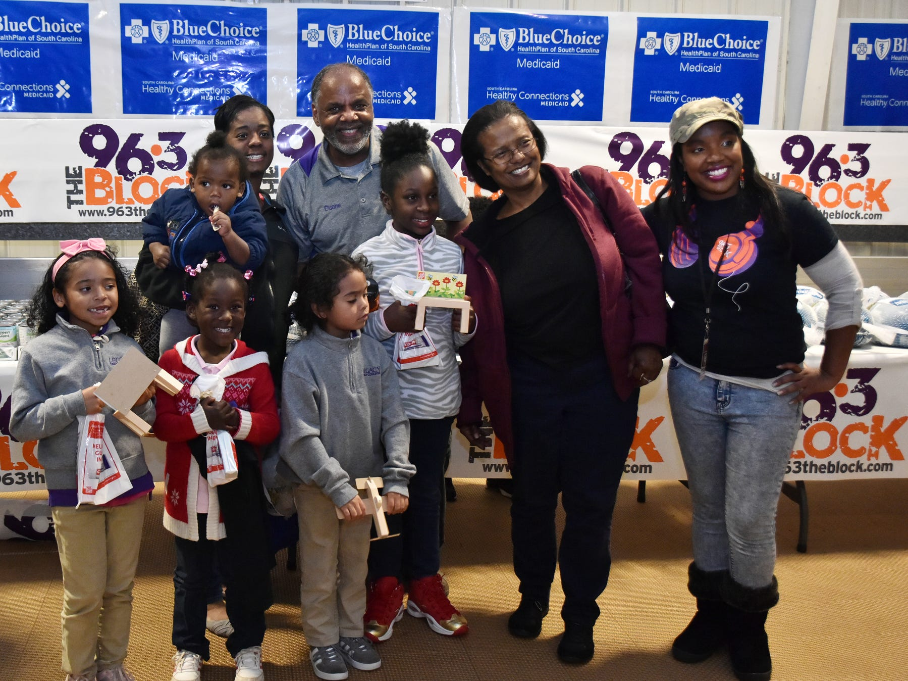 Duane Neal, an on-air personality at The Block, 96.3 in Greenville takes photos with members of the community during The Block presents The Steve Harvey Morning Show Turkey Give at the Freetown Community Center Tuesday evening, November 20, 2018.