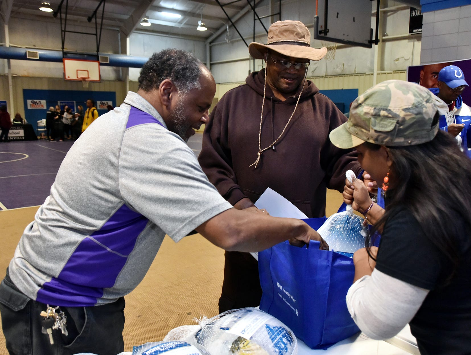 Duane Neal and Miranda Asson, on-air personalities at The Block, 96.3 in Greenville hands out turkeys during The Block presents The Steve Harvey Morning Show Turkey Give at the Freetown Community Center Tuesday evening, November 20, 2018.