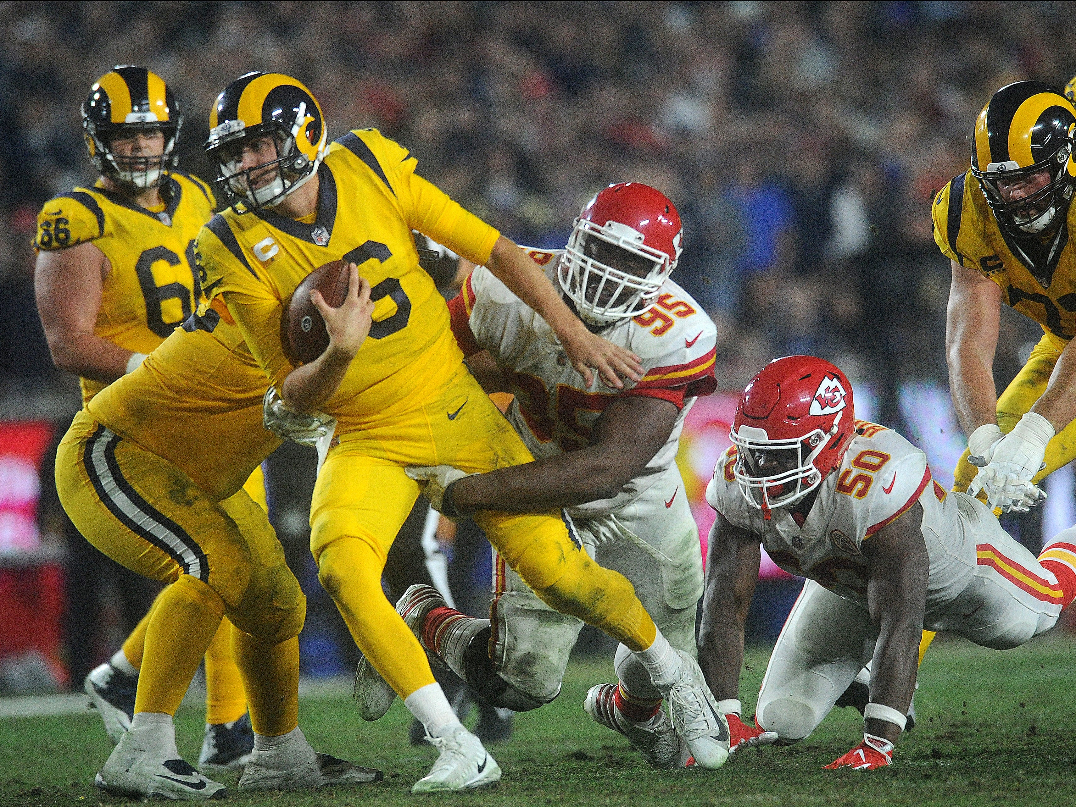 Rams quarterback Jared Goff breaks away from Chris Jones (95) of the Chiefs on Monday night. Goff completed 31 of 49 passes for 413 yards and four touchdowns and ran for another in a record breaking 54-51 epic battle with the Chiefs on Monday night.