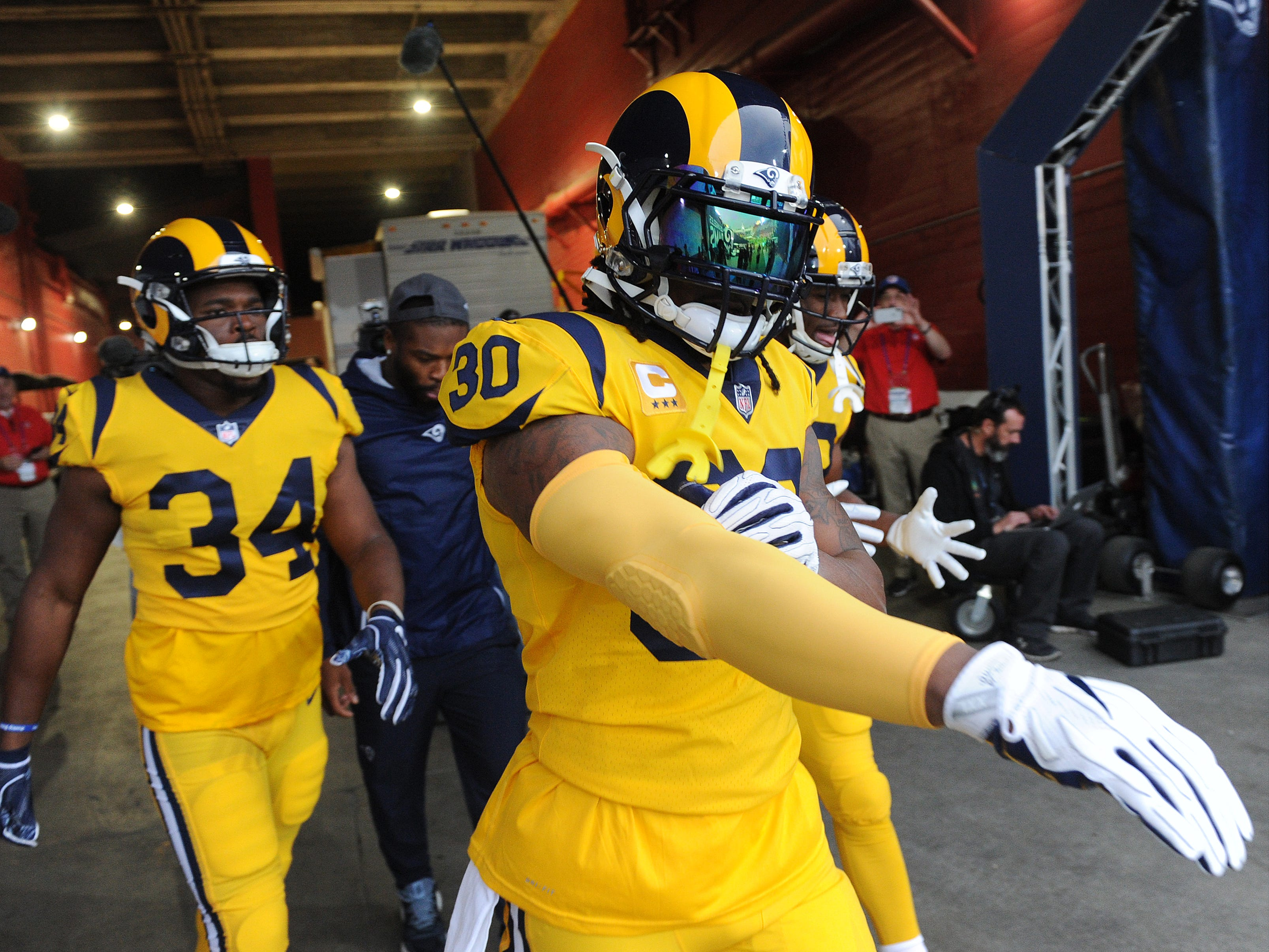 Todd Gurley, right, and Malcolm Brown (34) take the field for Monday night's game against the Chiefs