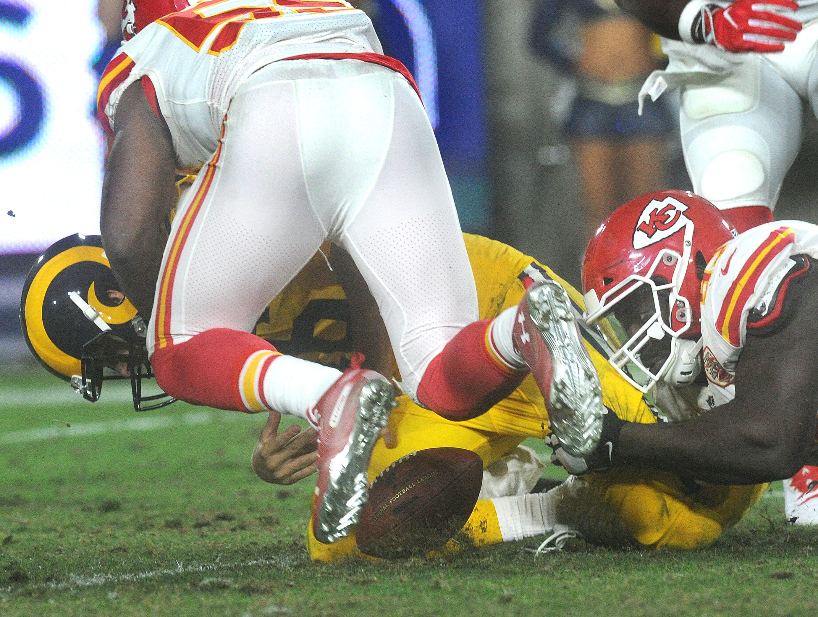 Rams quarterback Jared Goff fumbles away the ball and the Chiefs recovered. But Goff completed 31 of 49 passes for 413 yards and four touchdowns and ran for another in an epic 54-51 battle against the Chiefs on Monday night.