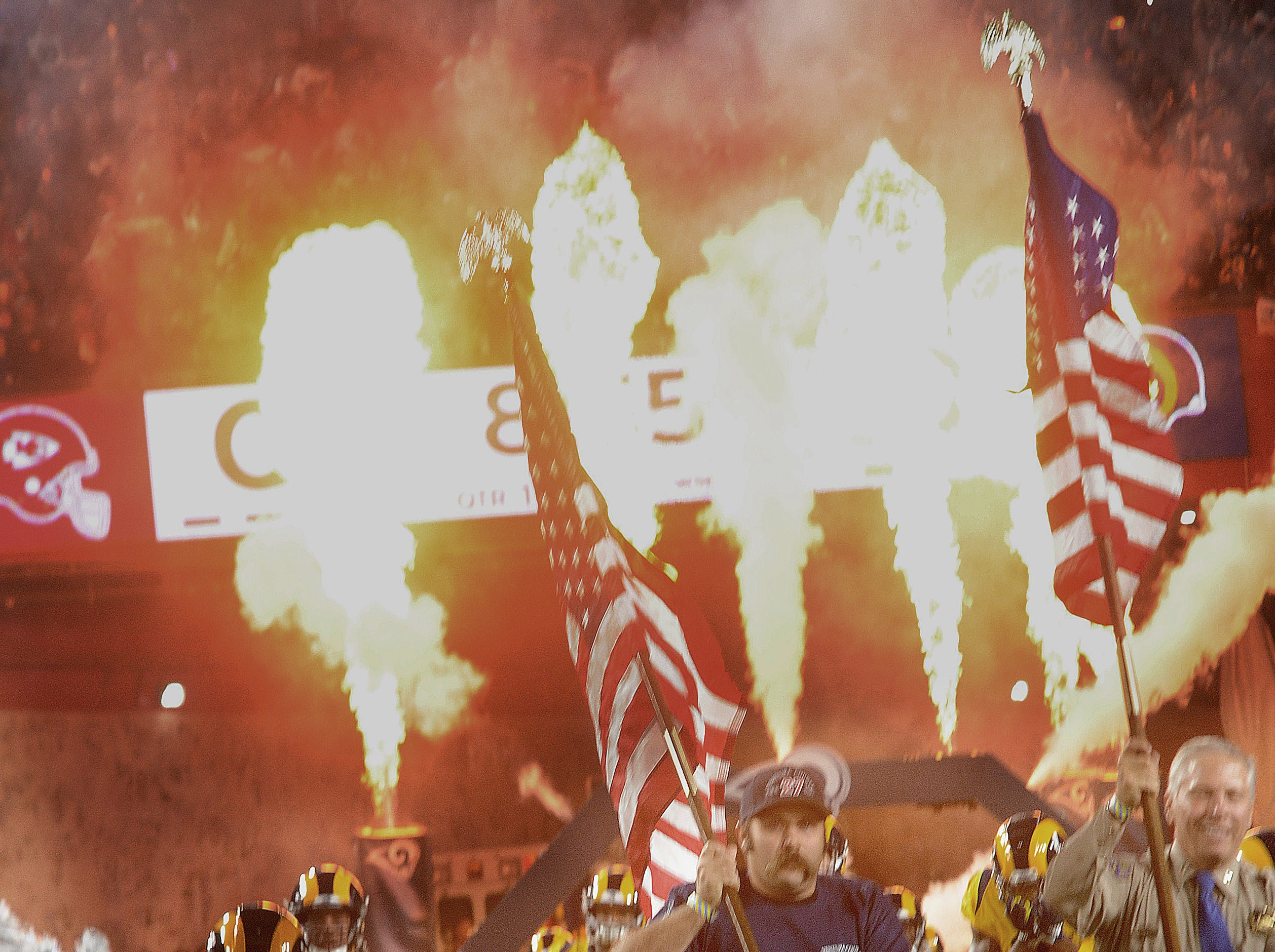 First responders from the recent fires and mass shooting lead the Rams onto the field before the Monday night game against the Chiefs.
