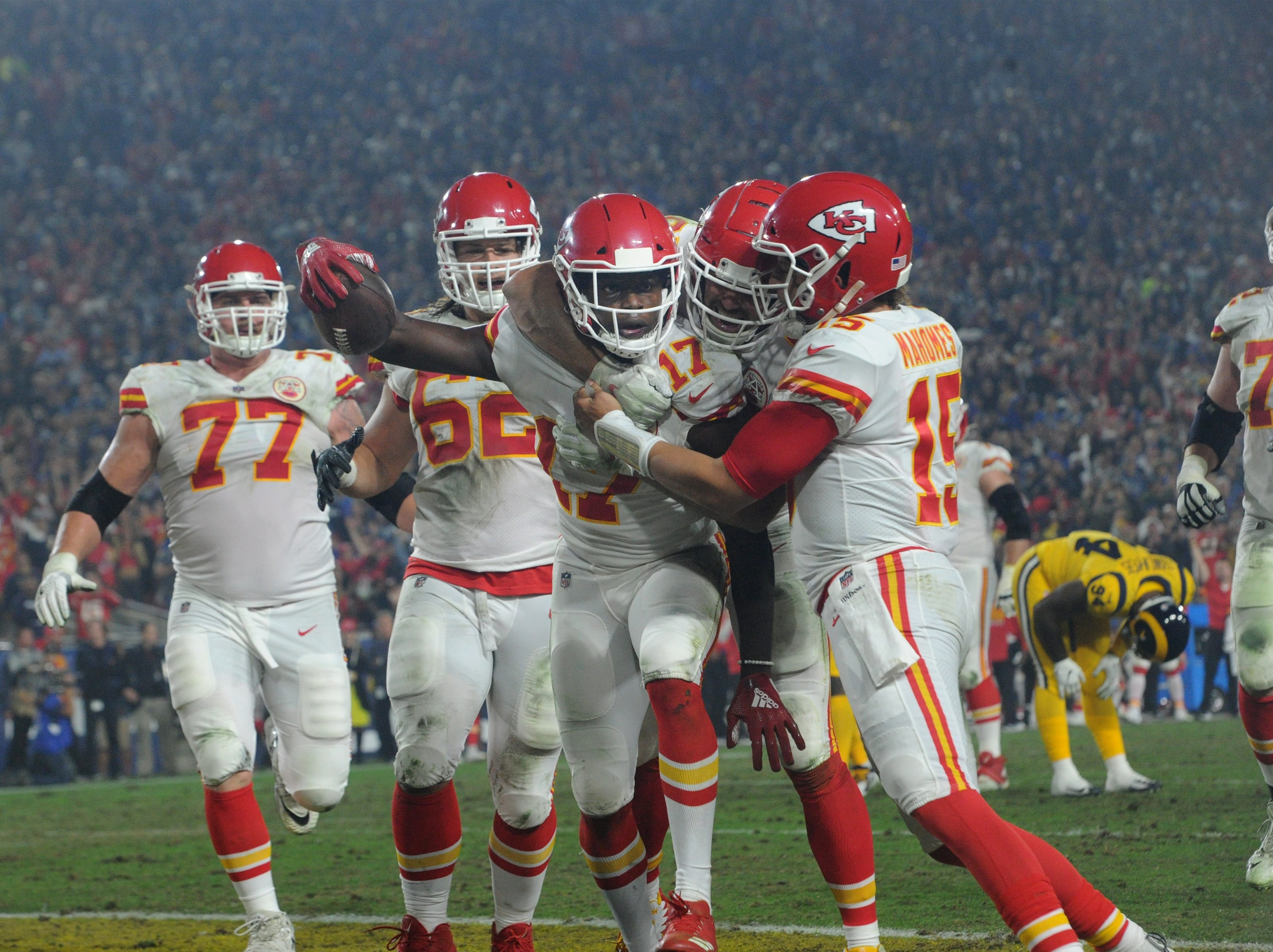 The Chiefs' Chris Conley (17) celebrates one of his two touchdown receptions from Patrick Mahomes on Monday against the Rams at the Coliseum.