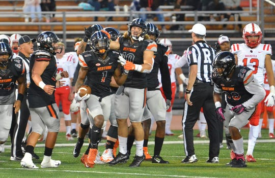 Trennan Carlson (10) celebrates with cornerback Jaylen Watson (1) after a turnover by the Ventura College defense during a game against Bakersfield earlier this season.