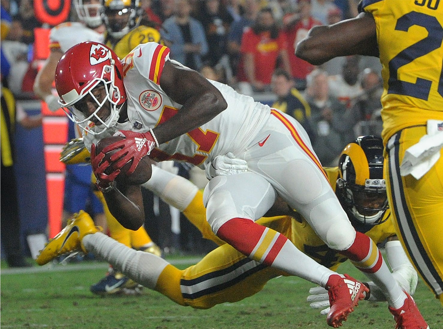 The Chiefs' Chris Conley (17) gains yardage adfter a pass reception on Monday against the Rams at the Coliseum.