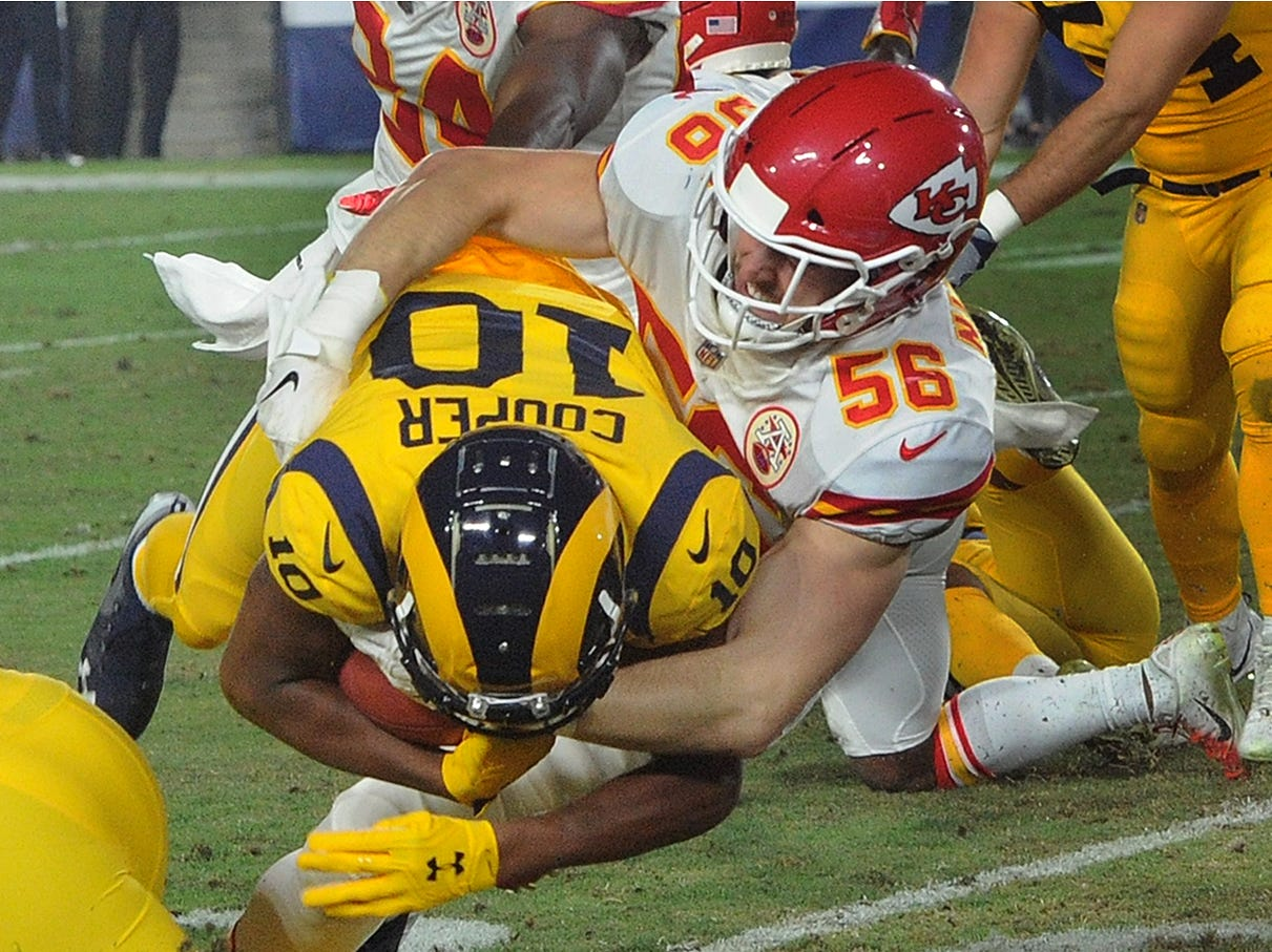 Pharoh Cooper, left, is tackled by Ben Niemann of the Chiefs.