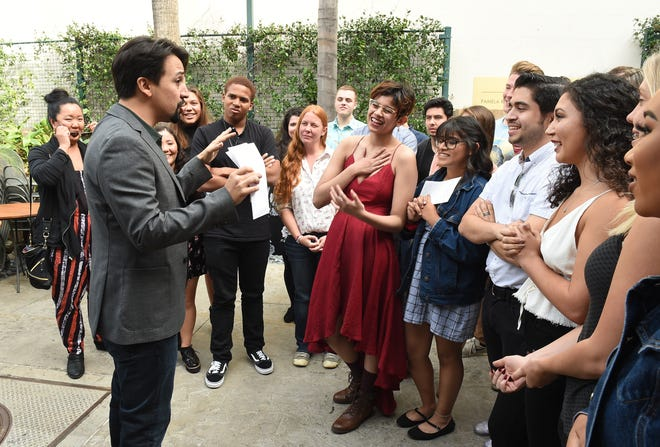 """Lin-Manuel Miranda meets CSU Channel Islands students who had to postpone and shorten their run of Miranda's play """"In the Heights"""" due to the Woolsey and Hill fires, just days after some of them lost friends in the shooting at the Borderline Bar & Grill shooting."""