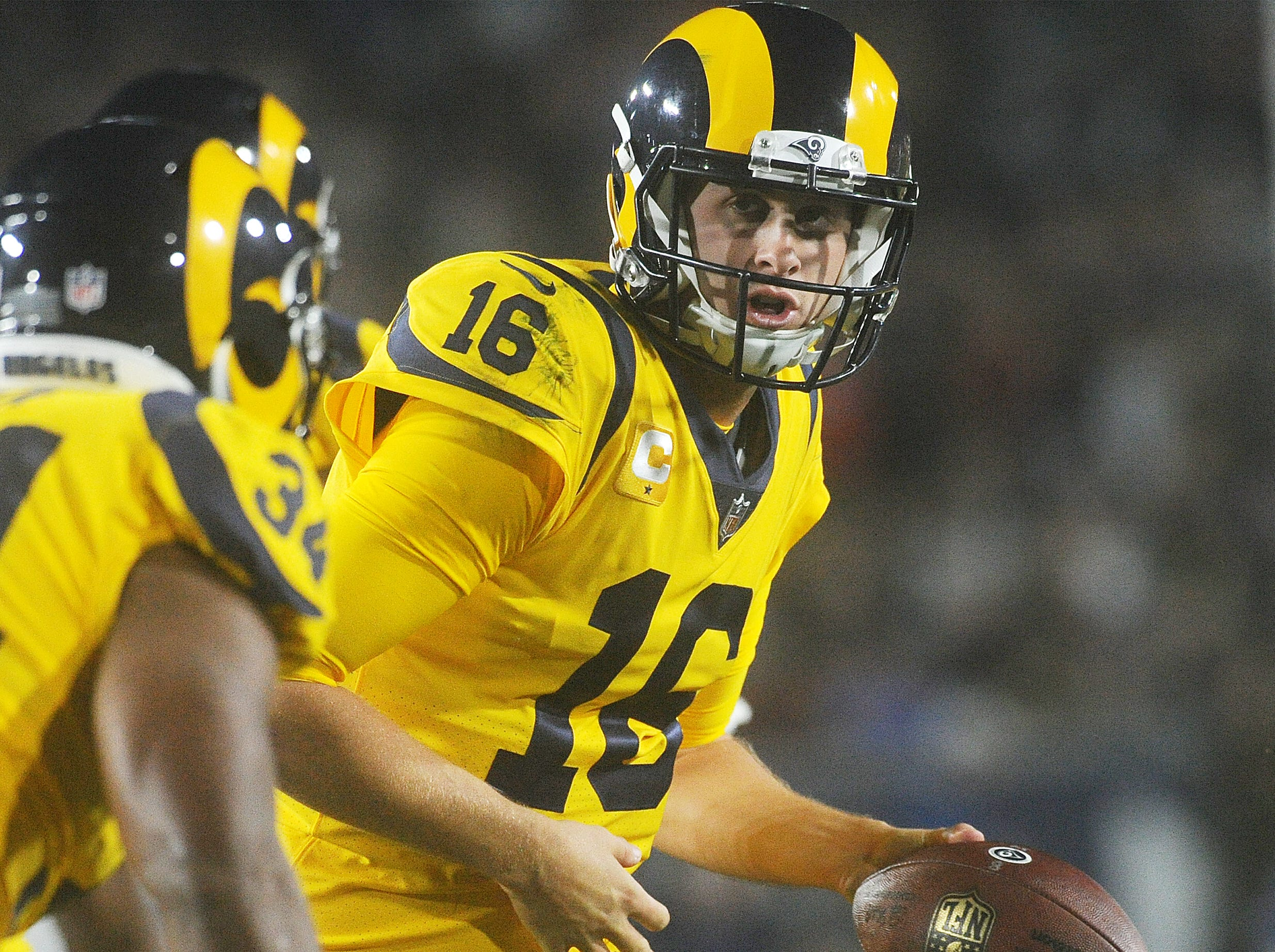 Rams quarterback Jared Goff hands the ball off against the Chiefs on Monday night. Goff completed 31 of 49 passes for 413 yards and four touchdowns and ran for another in a record-breaking 54-51 epic battle with the Chiefs on Monday night.