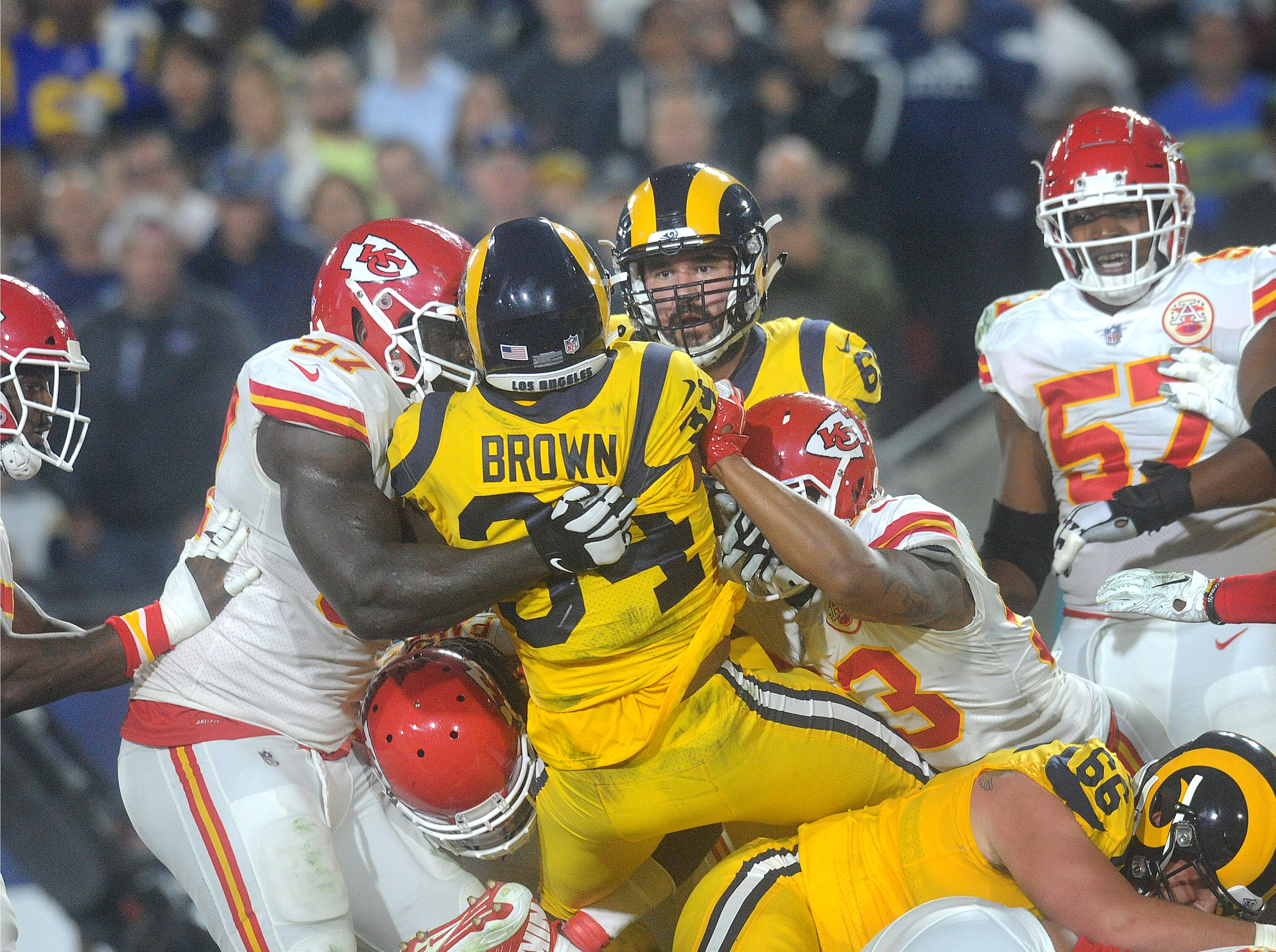 Malcolm Brown of the Rams is gang tackled by the Chiefs in a Monday night game at the Coliseum.