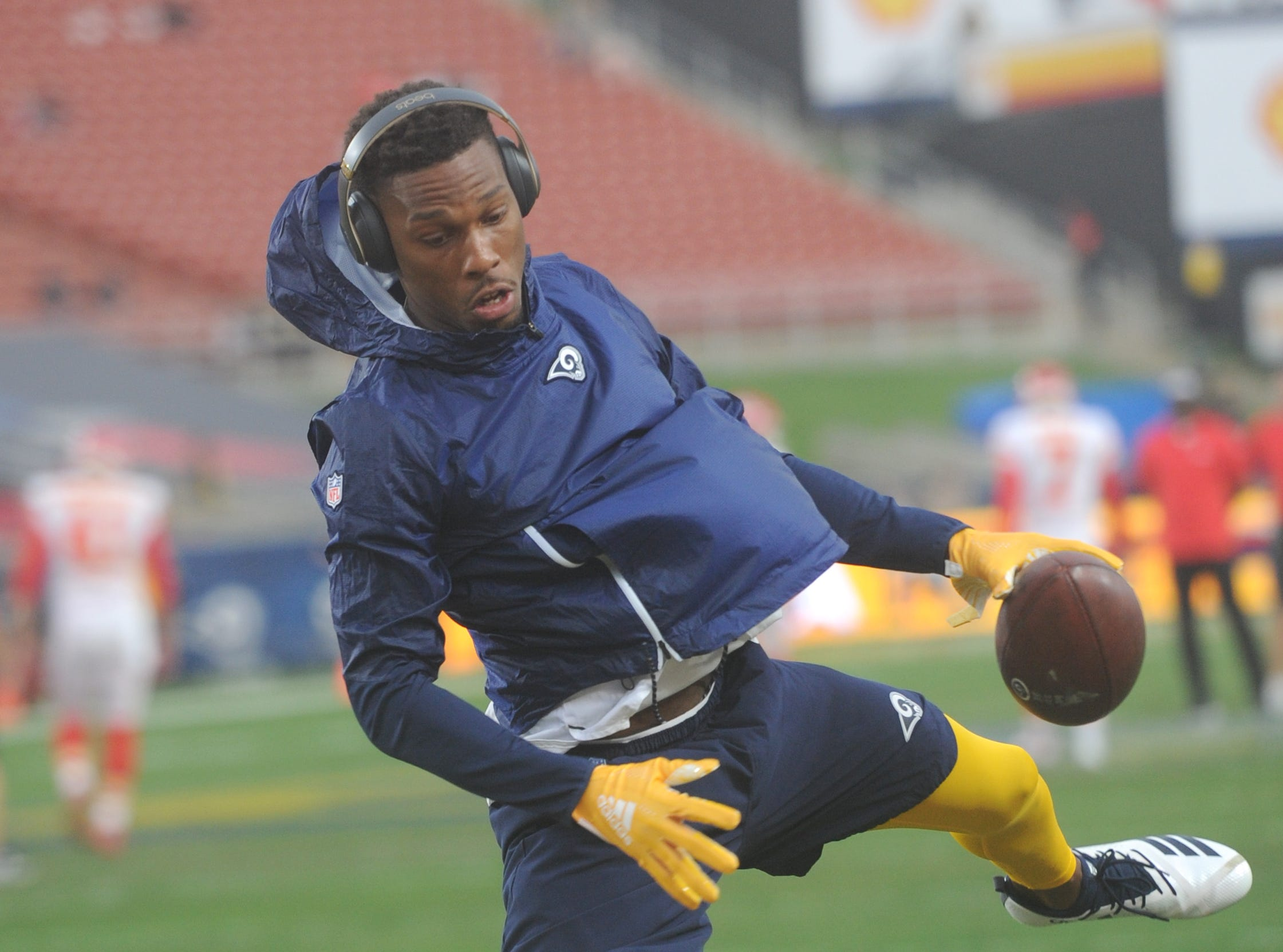 The Rams' Troy Hill warms up before the game with the Chiefs at the Coliseum before the Monday night game.