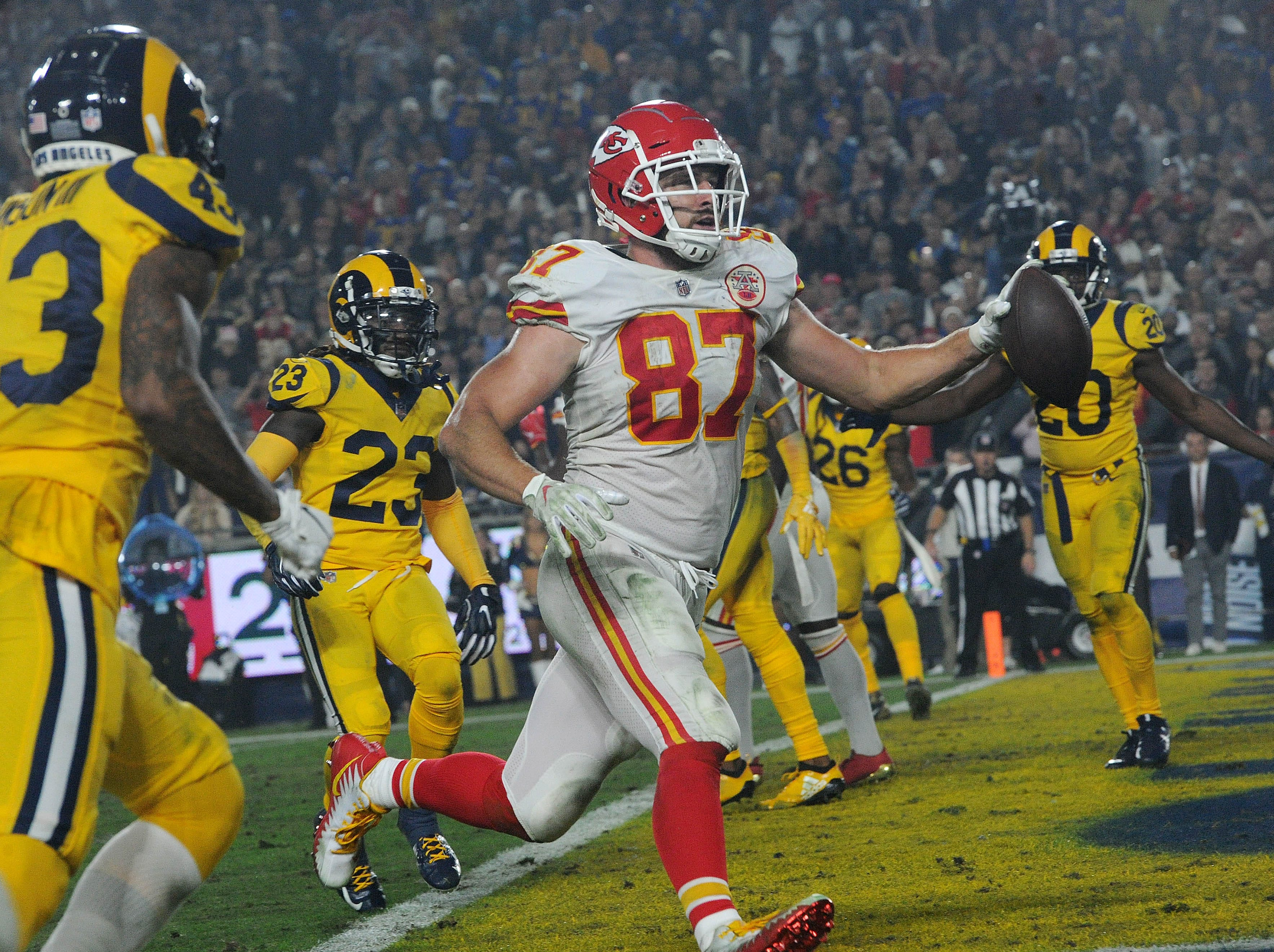 The Chiefs' Travis Kelce  catches a Patrick Mahomes touchdown pass on Monday against the Rams at the Coliseum.