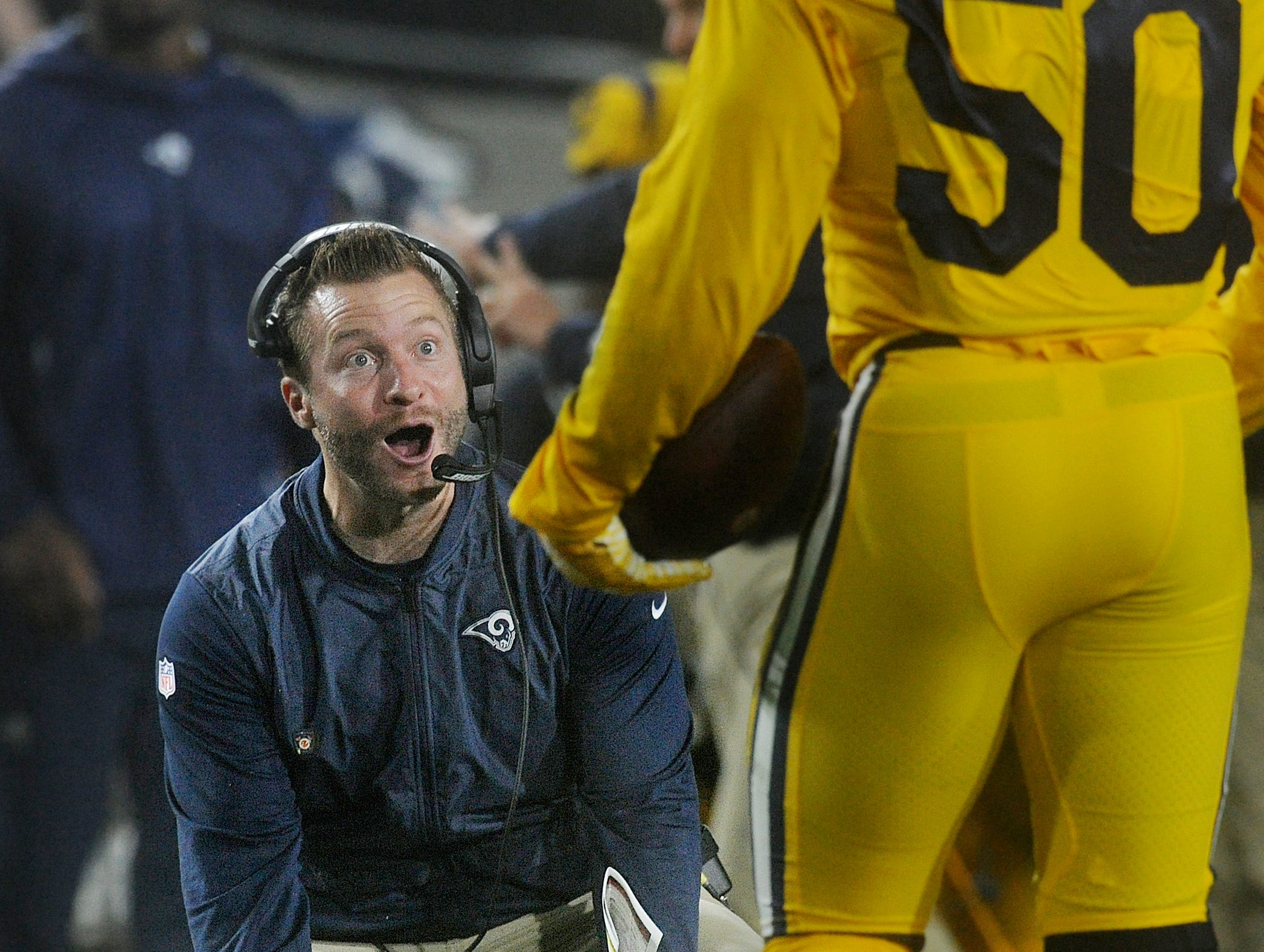 Coach Sean McVay reacts after Samson Ebukam (50) scores a touchdown on a fumble recovery in the 2nd quarter against the Chiefs on Monday night. He later intercepted a pass and scored his second TD of the game. The Rams won by a score of 54-51. The combined 105 points is the third-highest scoring NFL game in history and it marked the only time that two teams ever scored more the 50 points in the same game.