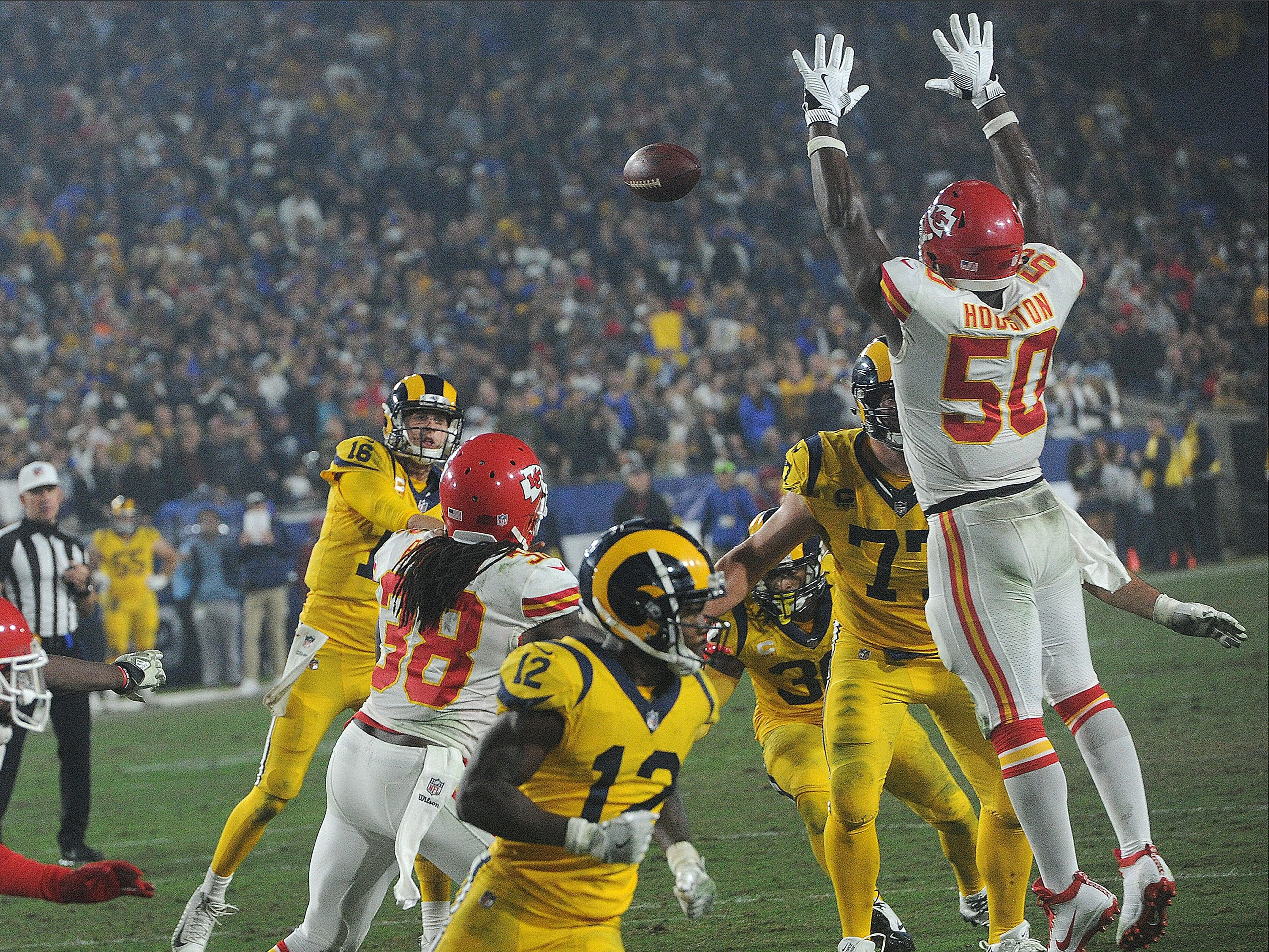 Rams quarterback Jared Goff throws a pass against the Chiefs on Monday night. Goff completed 31 of 49 passes for 413 yards and four touchdowns and ran for another in a record breaking 54-51 epic battle with the Chiefs on Monday night.
