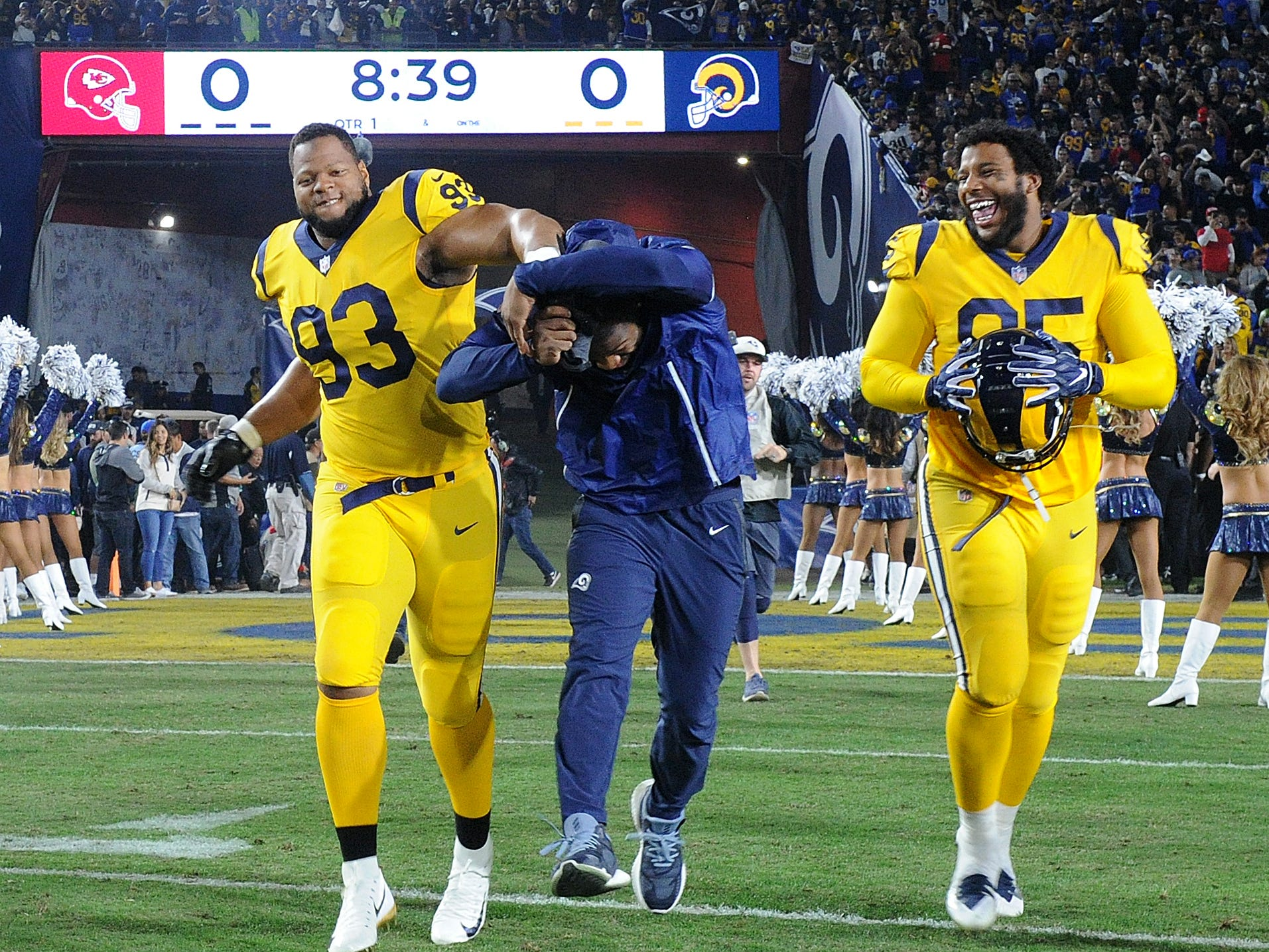 Thje Rams' Ndamukong Suh, left, and Ethan Westbrooks, right, joke around before the game against the Chiefs on Monday night.