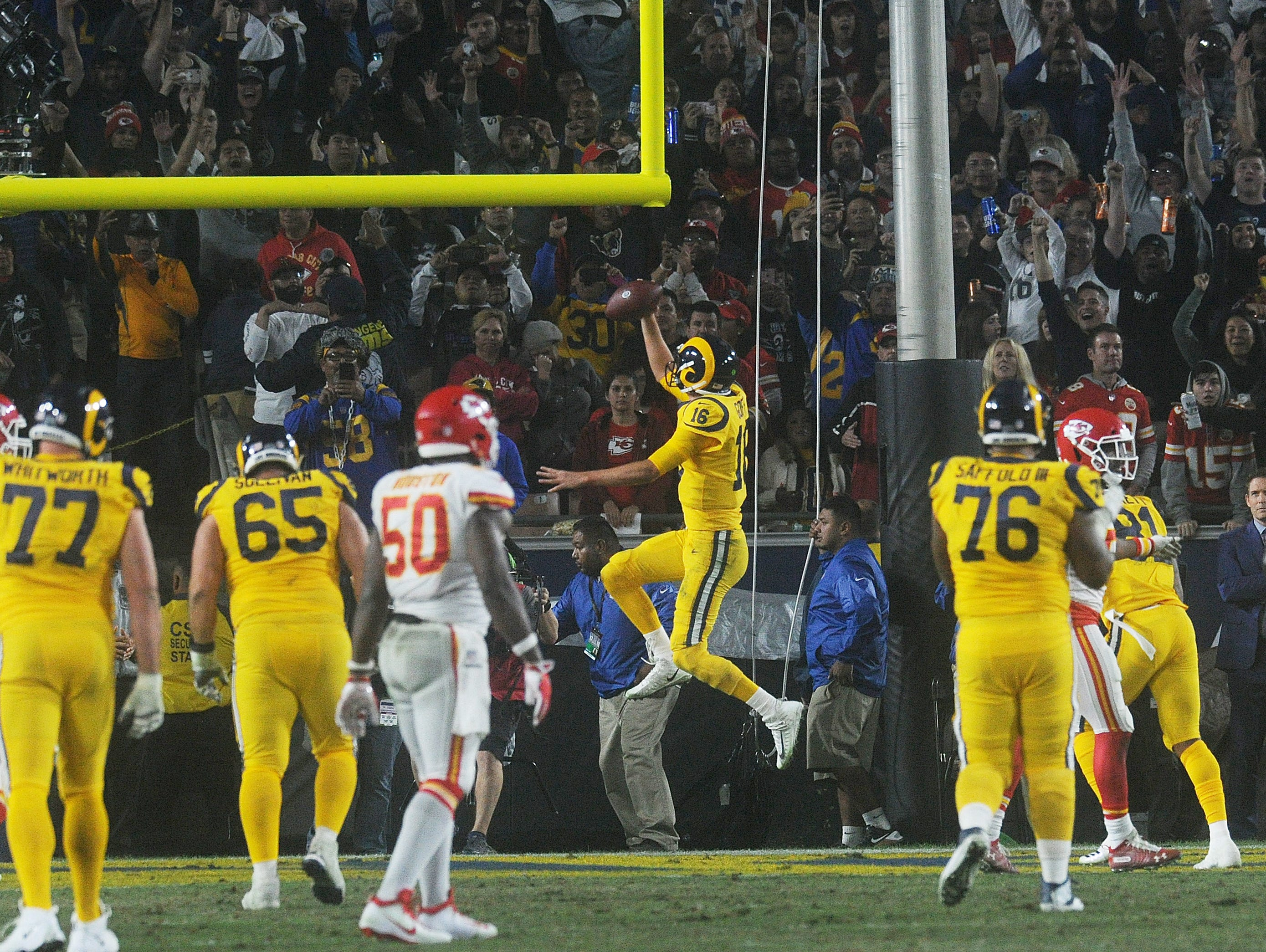 Rams quarterback Jared Goff scores a touchdown on a touchdown run. Goff completed 31 of 49 passes for 413 yards and four touchdowns in an epic 54-51 battle against the Chiefs on Monday night.
