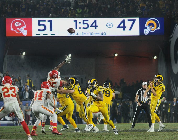 Rams quarterback Jared Goff, right, throws the winning touchdown pass to Gerald Everett, with 1:54 showing on the clock in the fourth quarter, against the Chiefs. The final score of 54-51 and combined 105 points made the game the third-highest-scoring NFL game in history and it marked the only time that two teams ever scored more the 50 points in the same game.