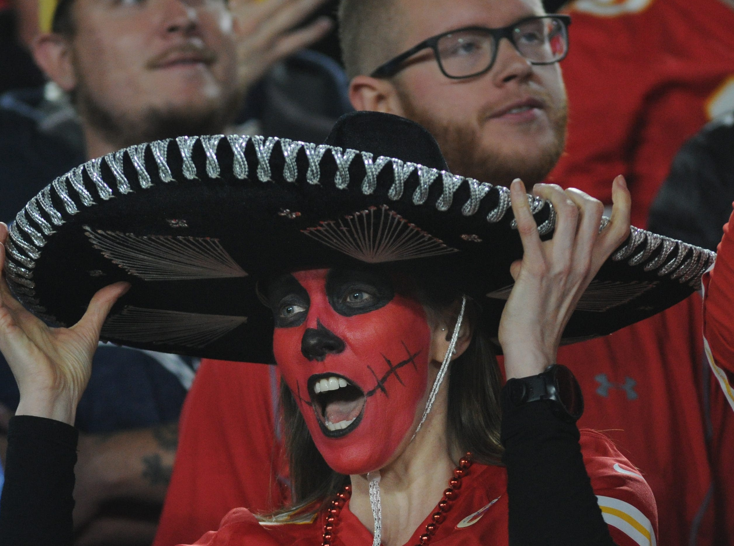 A Chiefs fan cheers for the team on Monday against the Rams at the Coliseum.