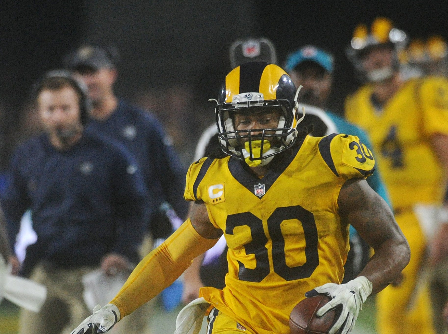 The Rams' Todd Gurley carries the ball on Monday against the Rams at the Coliseum. Gurley carried the ball only 12 times for 55 yards.