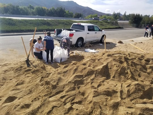 People fill sandbags Wednesday near Los Angeles County Fire Station No. 89 in Agoura Hills.