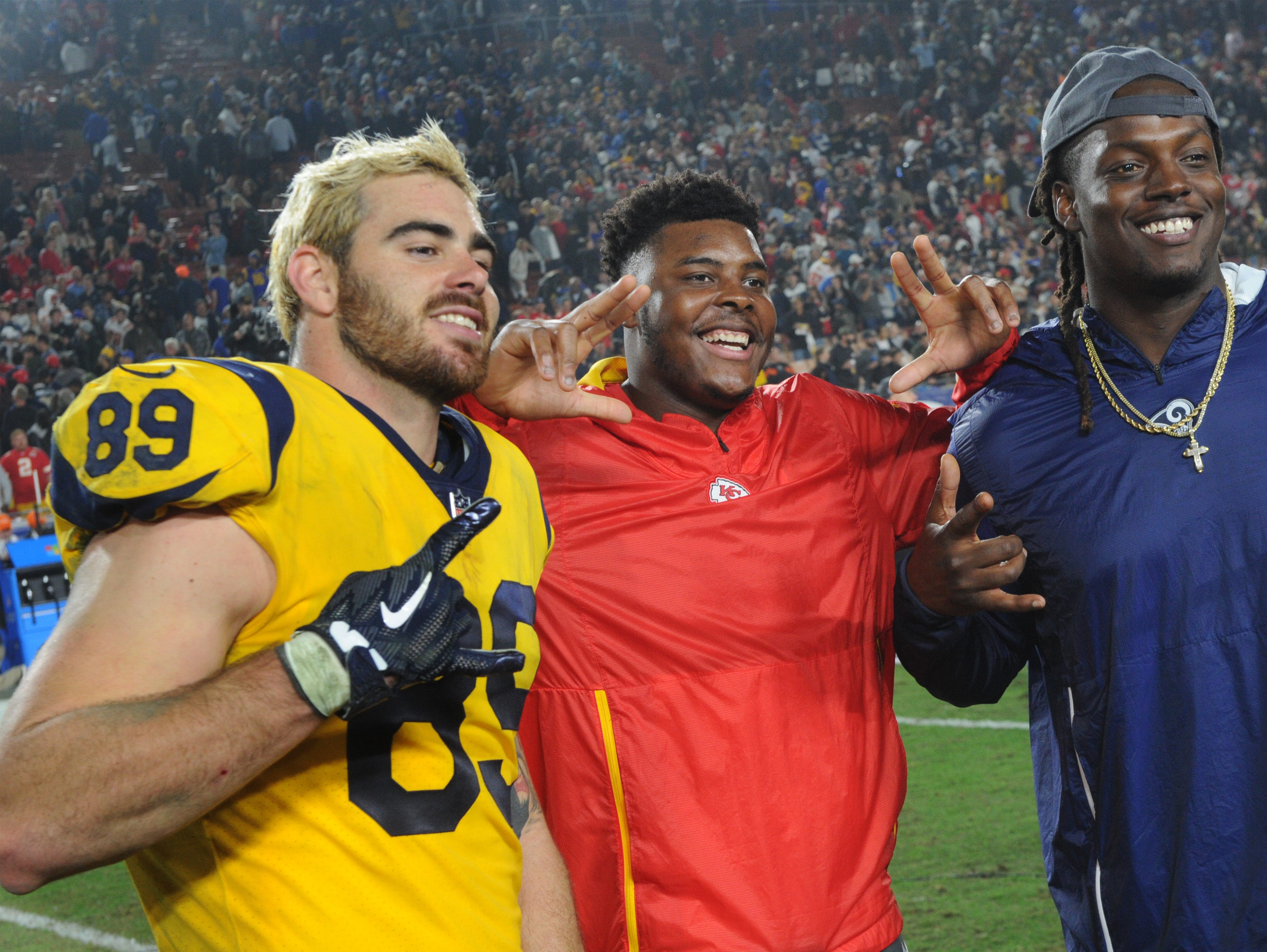 The Rams' Tyler Higbee, left, is all smiles with friends after the game.