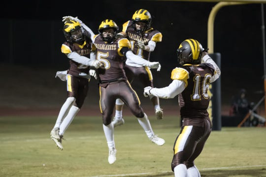 The Golden West High football team celebrates after a play in a Central Section Division IV high school football semifinal playoff game between Wasco and Golden West on Friday, November 16, 2018.