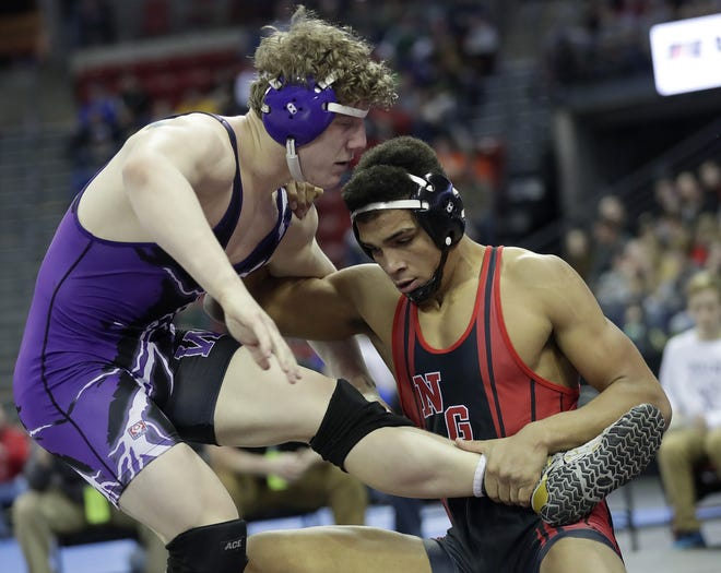 Neillsville/Greenwood/Loyal's Stephen Buchanan, right, battles Andrew Henschel of Wautoma/Wild Rose in the Division 2 182 pound semifinals at the WIAA state individual wrestling tournament in February. The Loyal senior has signed a national letter of intent to wrestle at Wyoming.