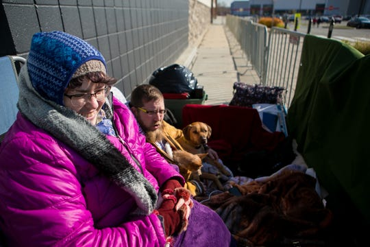 Erin Coyle and her boyfriend, Mike Farrar of Claymont, are the first shoppers in line for Black Friday at the Best Buy store in the Christiana Fashion Center.