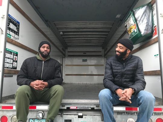 LaDaye Johnson and his brother, Jaron Johnson (left to right) handed out 400 turkeys from a rented U-Haul Wednesday afternoon in Wilmington's East Side.