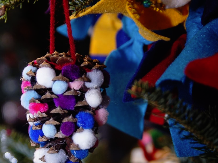 """Longwood has sponsored the Children's Tree program for more than 20 years. The MOT Charter School students' ornaments focused around being """"colorful and bright"""" using felt, string, pine cones, mini pom poms, and natural materials."""