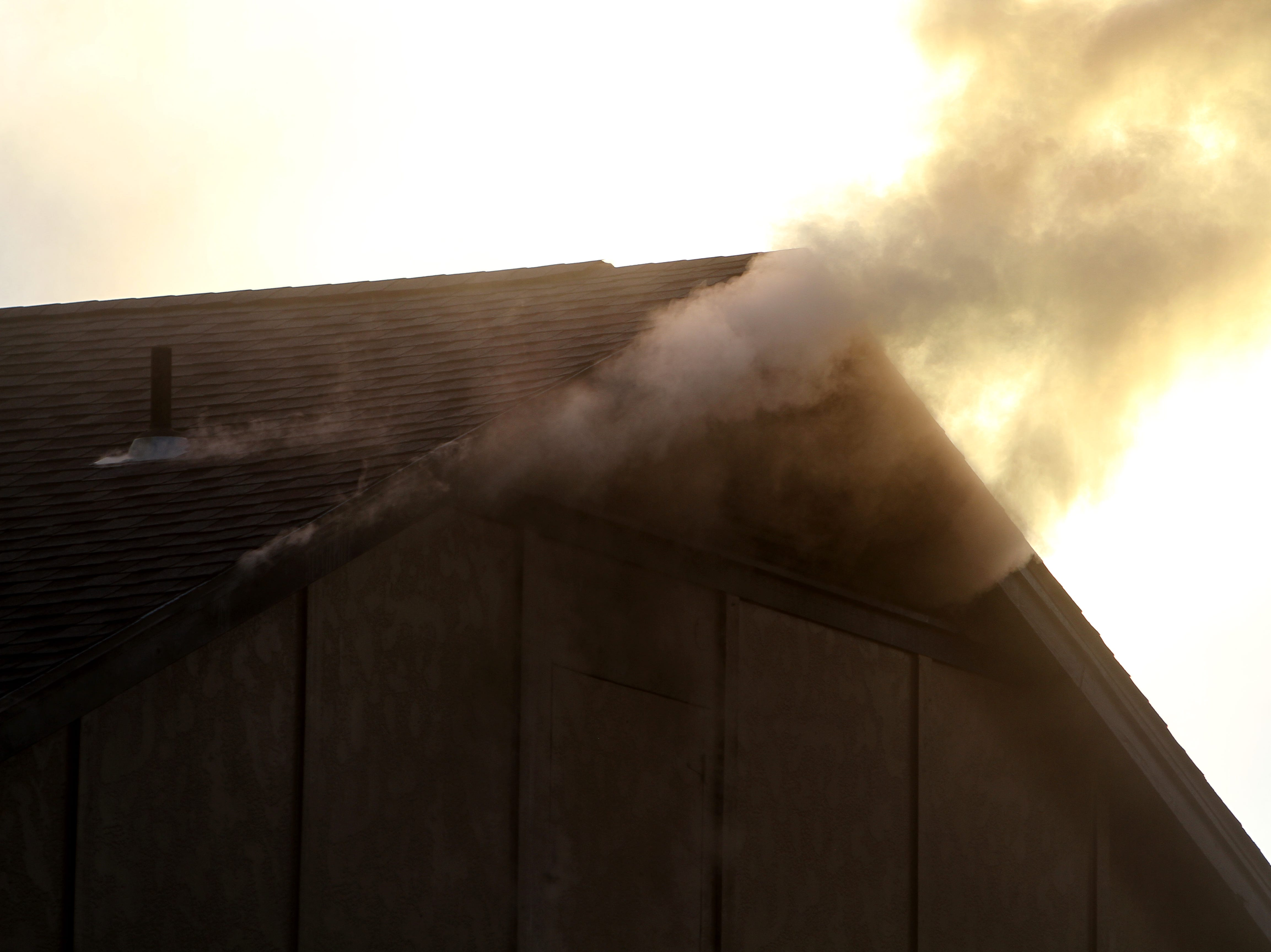 Smoke bellows out of the roof from a fire Tuesday, Nov. 20, 2018, at The Woodlands Apartment Homes on Midwestern Parkway.