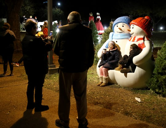 Families walk around the Fantasy of Lights Tuesday, Nov. 20, 2018, in the Midwestern State University front lawn.