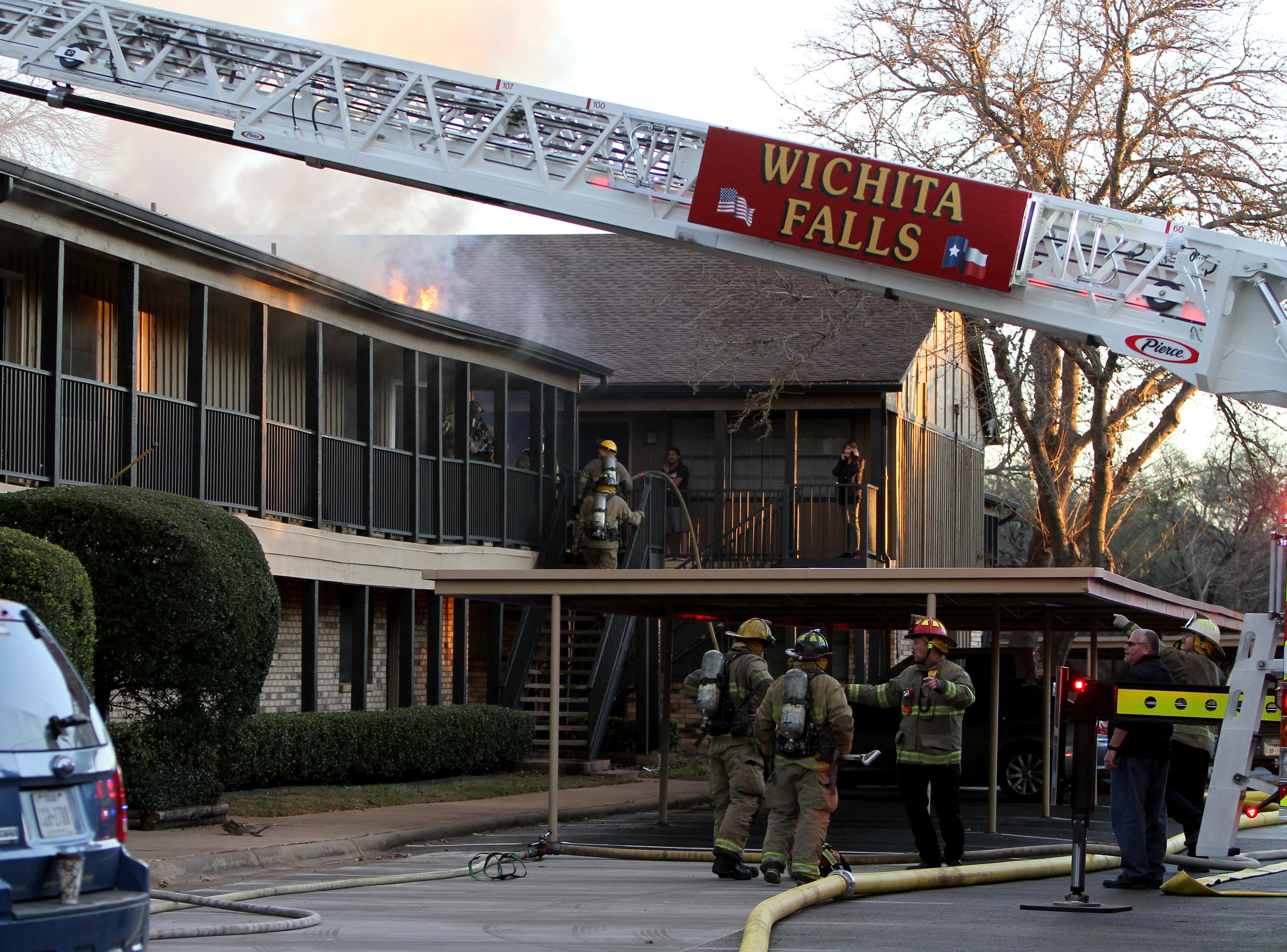 Firefighters work to put out a fire Tuesday, Nov. 20, 2018, at The Woodlands Apartment Homes on Midwestern Parkway.