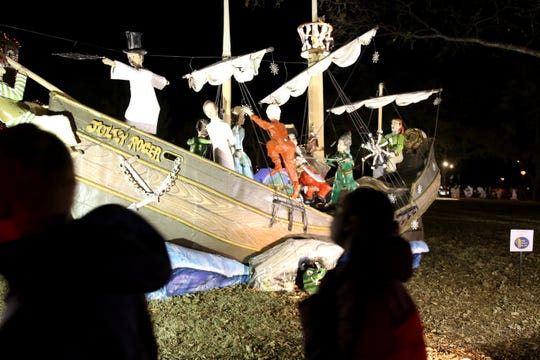 Families look at the displays at Fantasy of Lights Tuesday, Nov. 20, 2018, in the Midwestern State University front lawn.