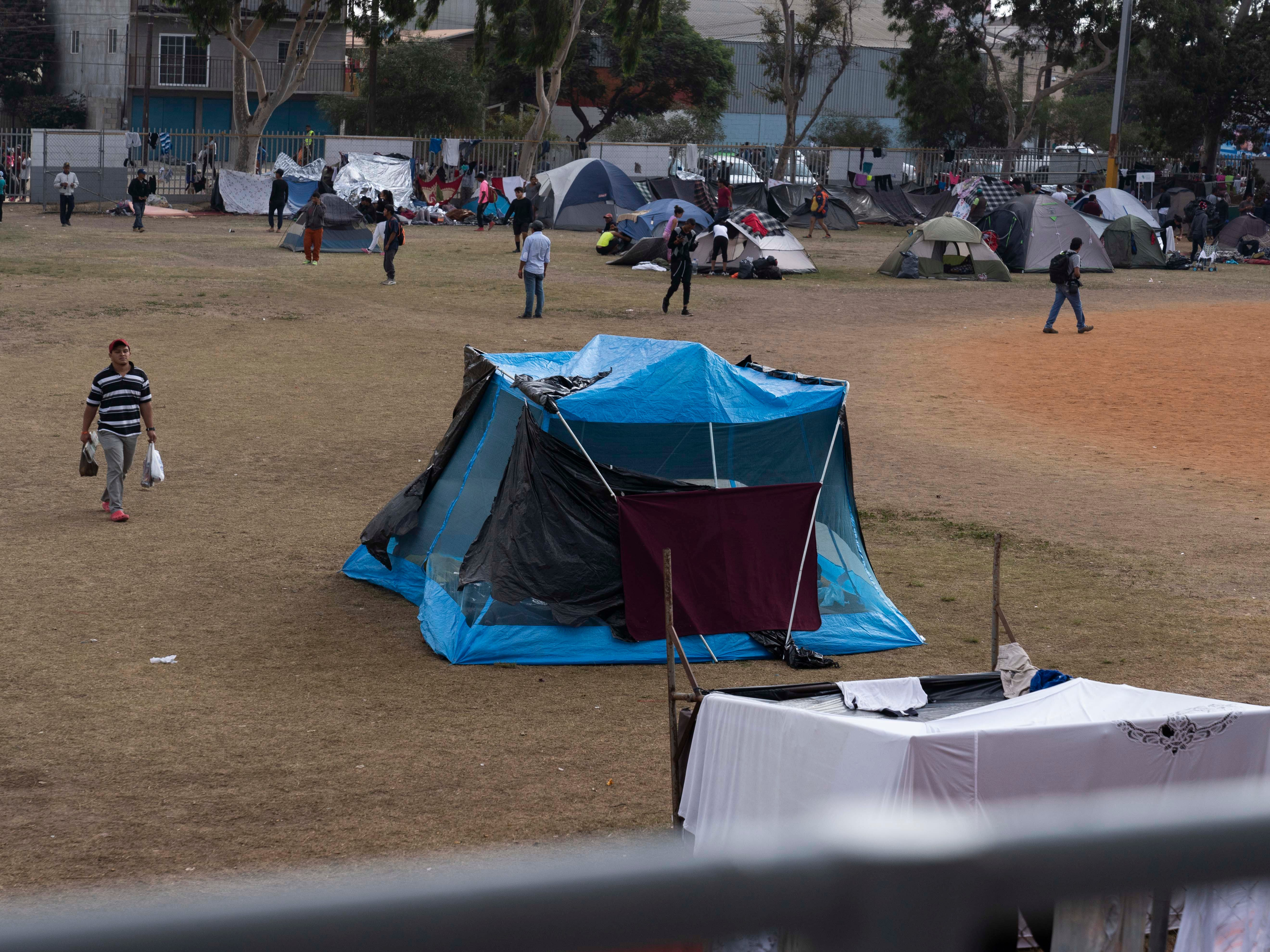 Over 2,500 Central American migrants live at the Unidad Deportiva Benito Juarez, a makeshift shelter, in Tijuana, Mexico on Nov. 20, 2018. Migrants set up camp around the baseball stadium.