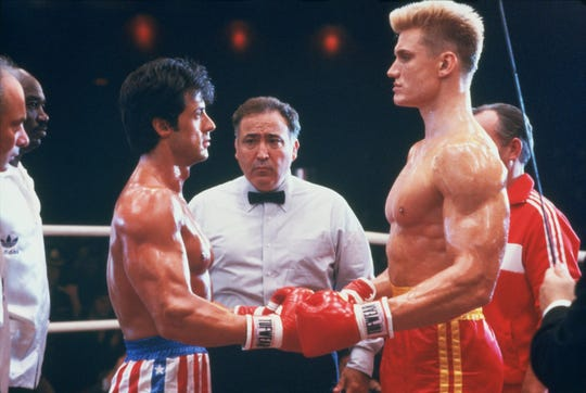 "Rocky (Sylvester Stallone, left) and Drago (Dolph Lundgren) square off in ""Rocky IV."""