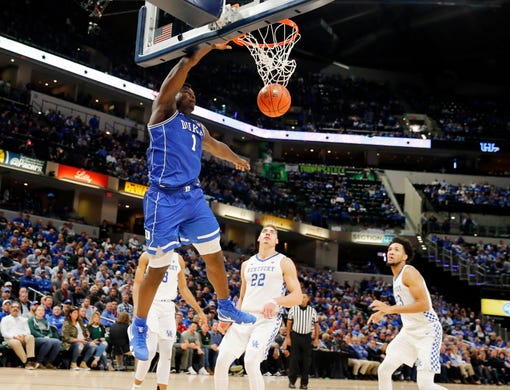 Nov 6, 2018; Indianapolis, IN, USA; Duke Blue Devils forward Zion Williamson (1) dunks against the Kentucky Wildcats in the second half during the Champions Classic at Bankers Life Fieldhouse. Mandatory Credit: Brian Spurlock-USA TODAY Sports