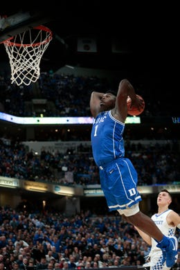 Zion Williamson (1) in action as Duke played Kentucky in an NCAA college basketball game at the Champions Classic.