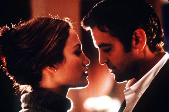 Jennifer Lopez, left, and George Clooney  play romantic cat-and-mouse in 1998's 'Out of Sight,' Steven Soderbergh's much-praised adaptation of an Elmore Leonard novel.